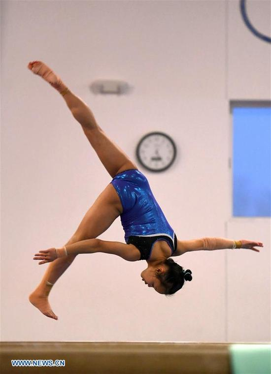 Li Qi, a member of China's women gymnastic team, is seen during training at Chow's Gymnastics and Dance Institute in West Des Moines, Iowa, the United States, on Dec. 27, 2017. Four Chinese women gymnasts have been attending a 20-day training program since Dec. 11. (Xinhua/Yin Bogu)