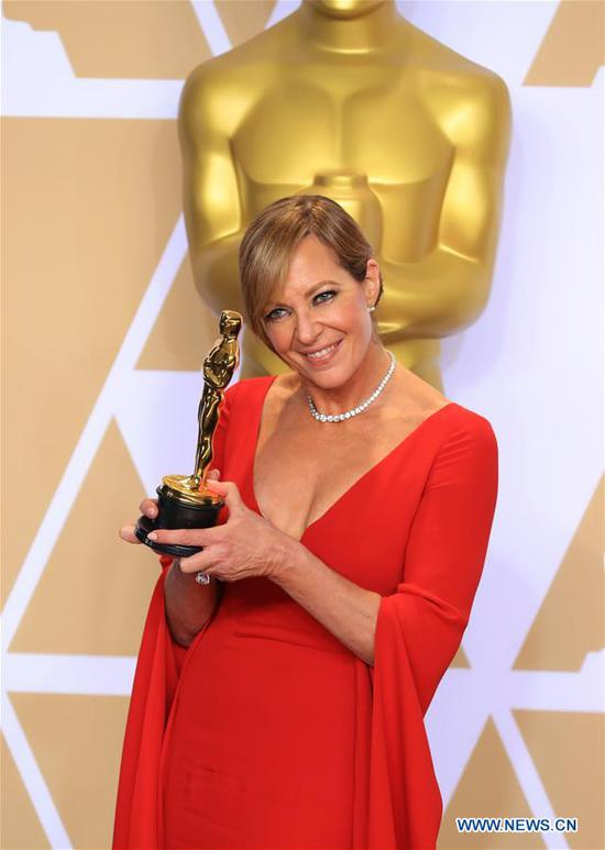 Actress Allison Janney poses after winning the Best Supporting Actress award for