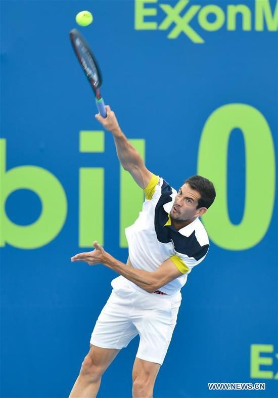 Guillermo Garcia-Lopez of Spain hits a return during the first round match against Feliciano Lopez of Spain at the ATP Qatar Open in Doha, Qatar, on Jan. 2, 2018. Feliciano Lopez won 2-1. (Xinhua/Nikku)