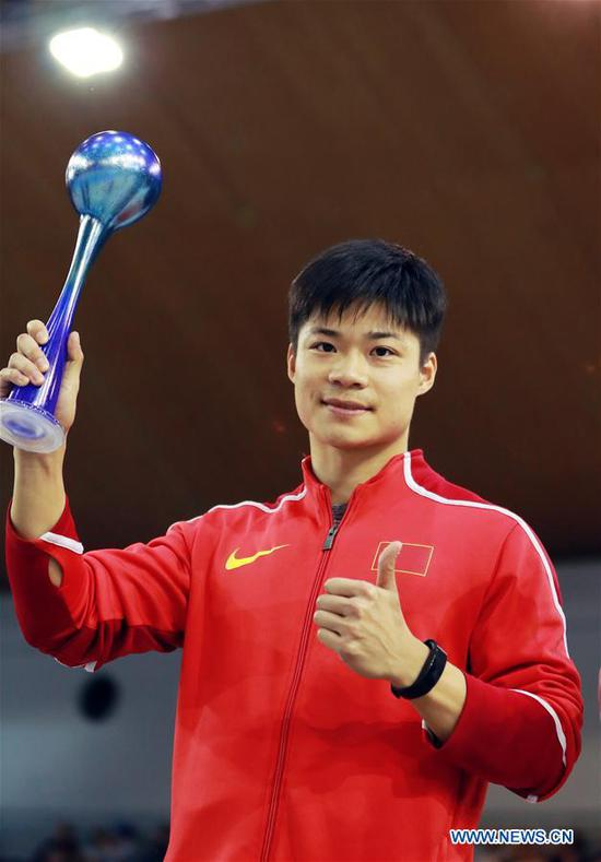 Su Bingtian of China attends the awarding ceremony after winning Men's 60m final of the 2018 IAAF World Indoor Tour in Karlsruhe, Germany, on Feb. 3, 2018. Su Bingtian claimed the title with 6.47 seconds.(Xinhua/Luo Huanhuan)