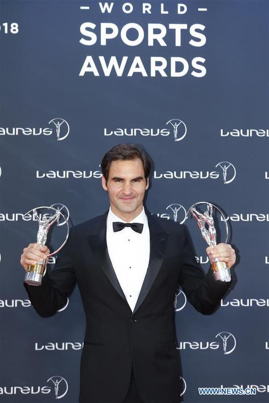 Swiss tennis player Roger Federer poses with the