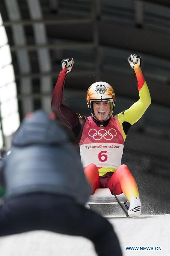 Natalie Geisenberger from Germany celebrates after crossing finishing line of women's singles event of luge at 2018 PyeongChang Winter Olympic Games at Olympic Sliding Centre, PyeongChang, South Korea, Feb. 13, 2018. Natalie Geisenberger claimed the champion in a time of 3:05.232.(Xinhua/Wu Zhuang)