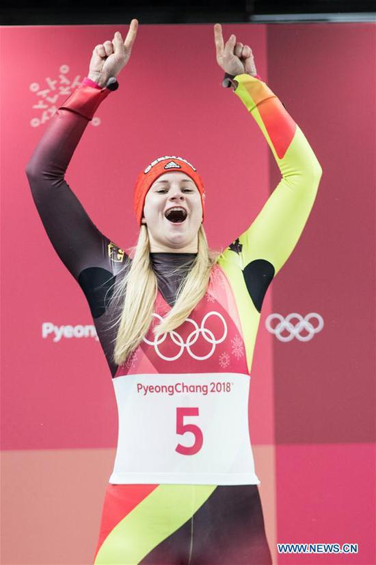 Dajana Eitberger from Germany celebrates during venue ceremony of women's singles event of luge at 2018 PyeongChang Winter Olympic Games at Olympic Sliding Centre, PyeongChang, South Korea, Feb. 13, 2018. Dajana Eitberger claimed the second place in a time of 3:05.599.(Xinhua/Wu Zhuang)