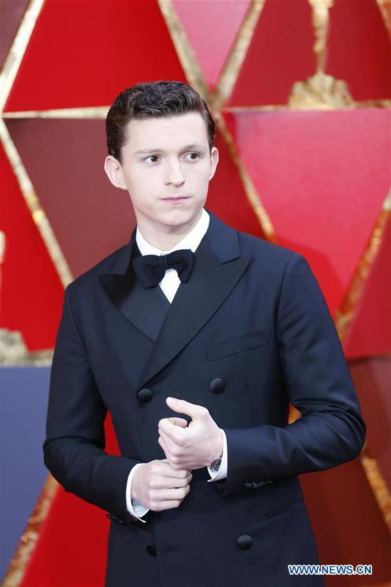 Actor Tom Holland arrives for the red carpet of the 90th Academy Awards at the Dolby Theater in Los Angeles, the United States, on March 4, 2018. (Xinhua/Li Ying)