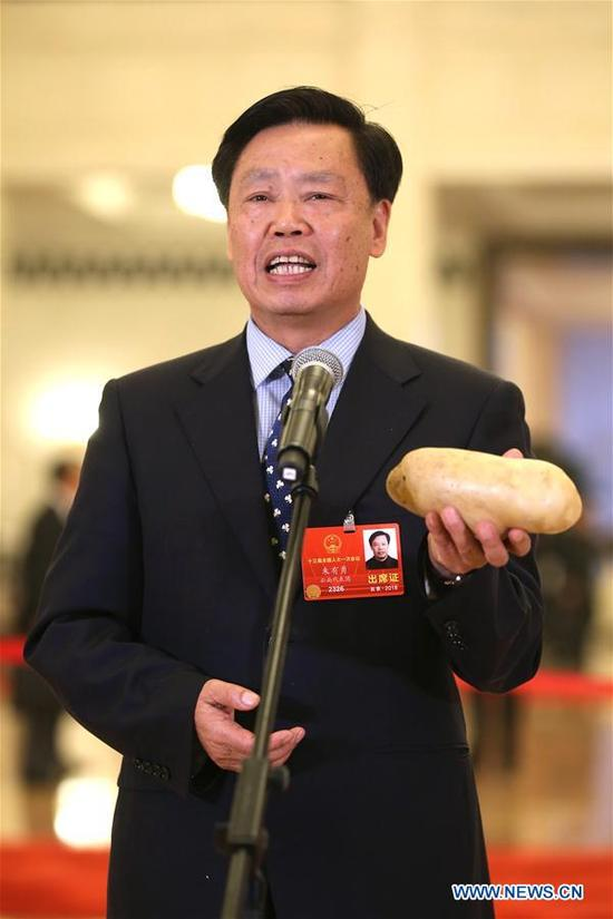 Zhu Youyong, a deputy to the 13th National People's Congress (NPC), receives an interview before the fourth plenary meeting of the first session of the 13th NPC in Beijing, capital of China, March 13, 2018. (Xinhua/Jin Liwang)