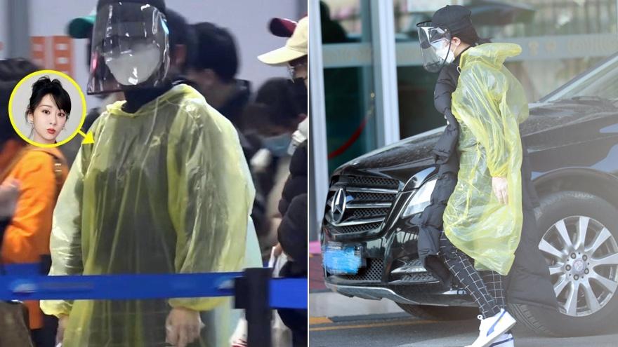 杨紫穿雨衣打扮高调现身机场 360度无死角防御十分到位