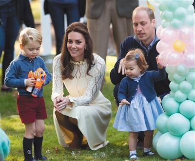 威廉王子与凯特王妃一家。资料图片/视觉中国