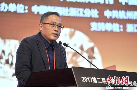 图为杭州市西湖区委常委、宣传部长吴向前发言 胡哲斐 摄