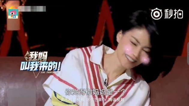 王菲害羞。