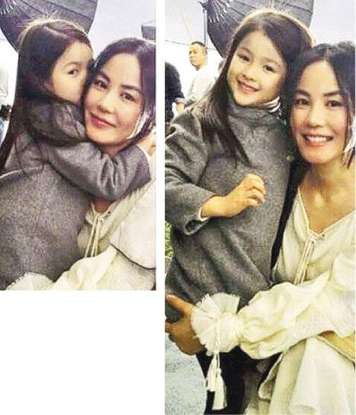 王菲抱起小女孩一起玩