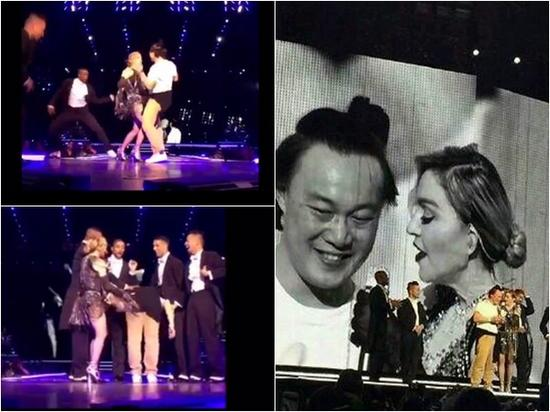 陈奕迅和麦当娜一起在舞台上玩得很疯,大方翘起屁股任对方打。