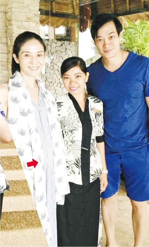 """日前杨采妮(左)跟丈夫邱韶智(右)被""""集邮"""",意外令采妮的孕肚曝光。"""