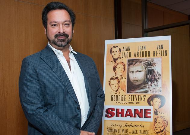 2013年,詹姆斯·曼高德参加《原野奇侠》放映会与海报合影