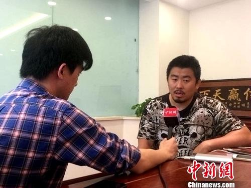 图为中新网记者专访徐晓冬。中新网记者 让宝奎 摄