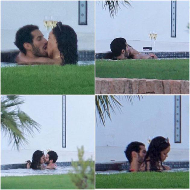 蕾哈娜西班牙度假 与神秘男子泳池嬉戏热吻(图)