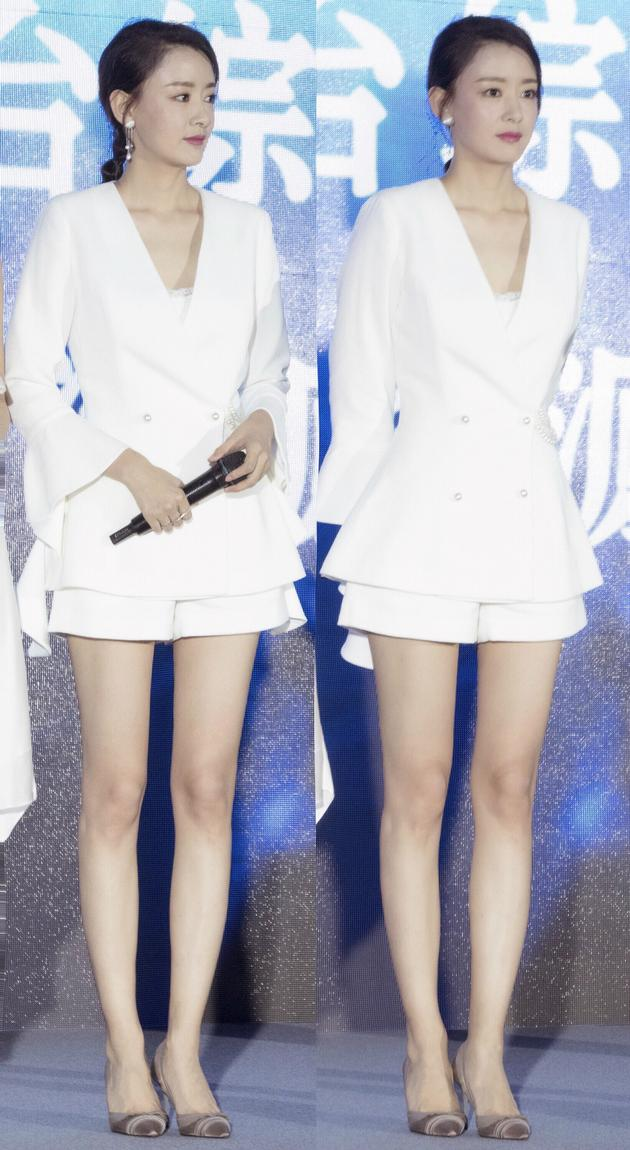 周奇奇演绎新时代女性 白色套装干练秀长腿