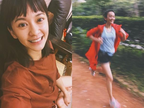 陈意涵挺孕肚跑步。