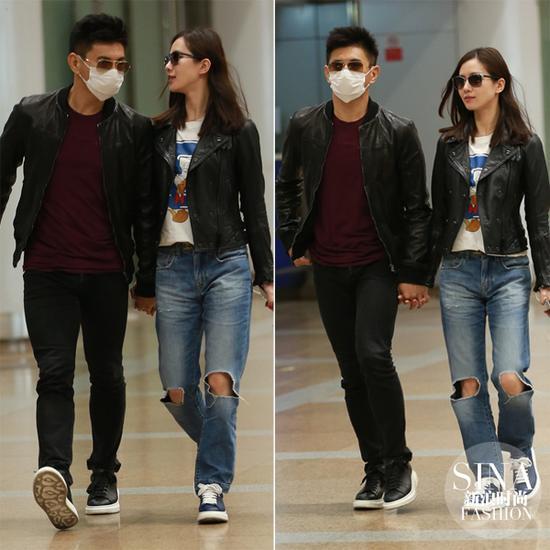 看看两人在机场耍酷,手都不愿放开