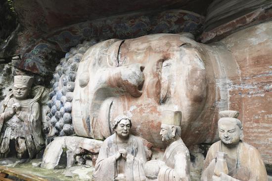 寶頂臥佛(釋迦涅盤圣跡圖)是大足石刻最大的一尊造像。