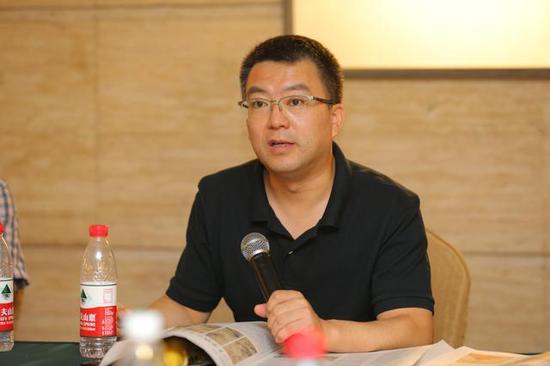 中国美术出版总社副编审教富斌