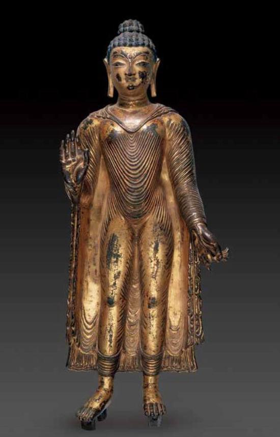 《释迦摩尼鎏金铜立像》, 克什米尔,7至8 世纪,西藏博物馆收藏