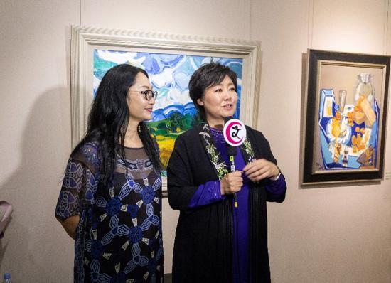 著名演员萨日娜, 作家、画家段威接受采访