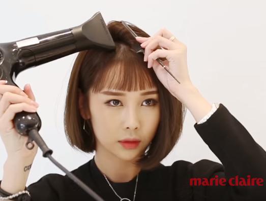 步骤图 步骤图   step3:用卷发棒烫卷内层的头发