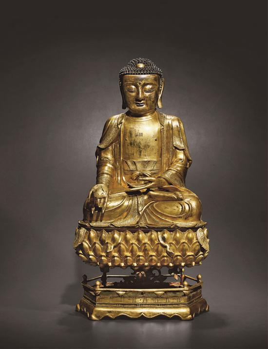 明•铜鎏金药师佛坐像   150万起拍,431.25万元成交。