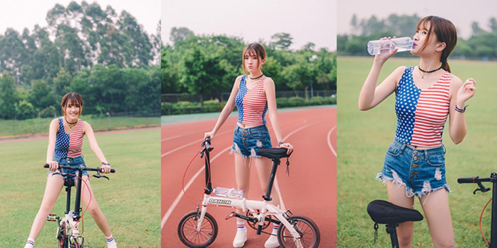 玩单车的可爱邻家美女
