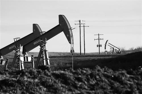 叙利亚局势趋稳 国际油价金价回落