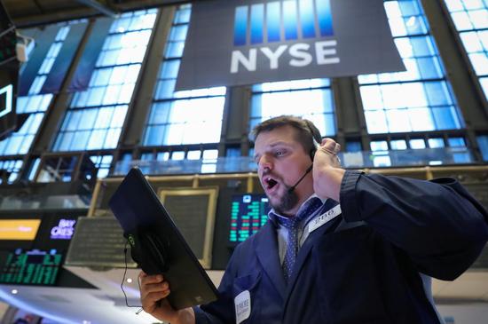 2019年3月13日,美国纽约,纽交所内交易员的工作场景。REUTERS/Brendan McDermid