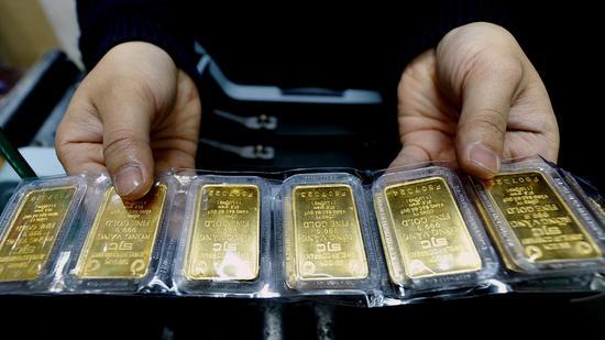 黄金期货价格周二小幅收高0.2% 重新站上1200关口