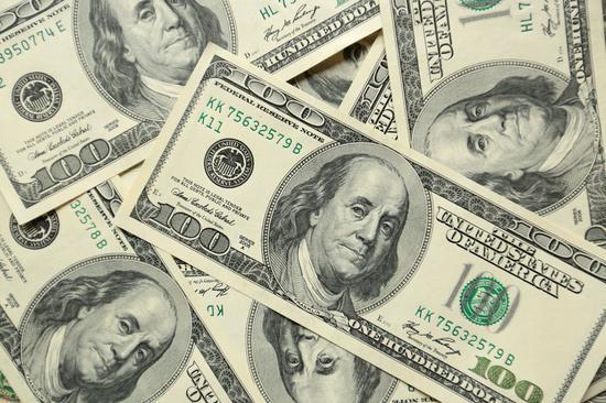 美元展开回调 人民币调整幅度收窄
