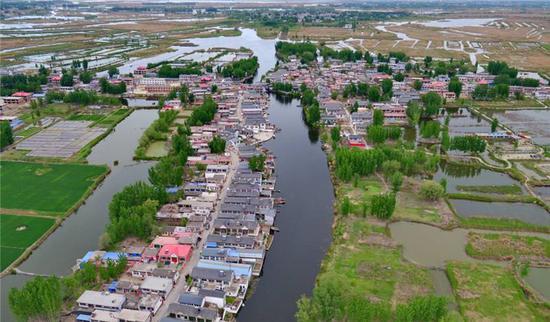 雄安现状一大特征:村落、工厂、田地、水域交融一体