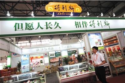 2014年,在北京举行的第十二届中国国际肉类工业展览会上的得利斯集团展台。图/视觉中国
