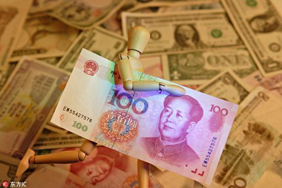 管涛:我国资本外流压力明显缓解 汇率维稳获超预期成功