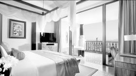 三亚海棠湾开维万达文华度假酒店豪华海景房的宣传照片。