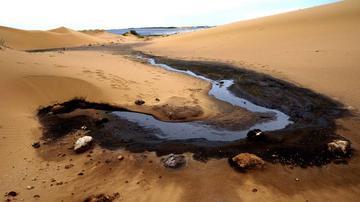 腾格里沙漠现污染 美利云或难脱干系