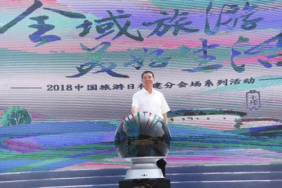 """福建省旅发委主任吴贤德发布""""放心游福建""""LOGO"""