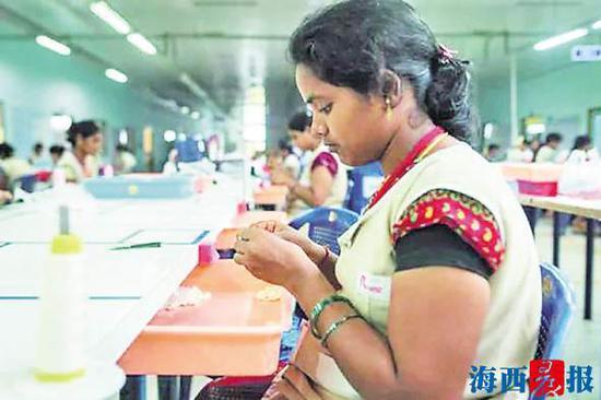 姚明织带印度公司的生产场景。(资料图)