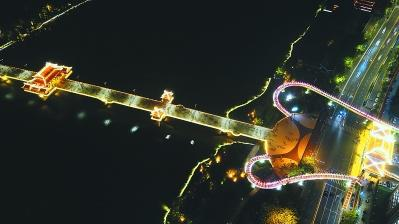 从空中看,漳州飘带天桥和南山廊桥就像一把大吉他。