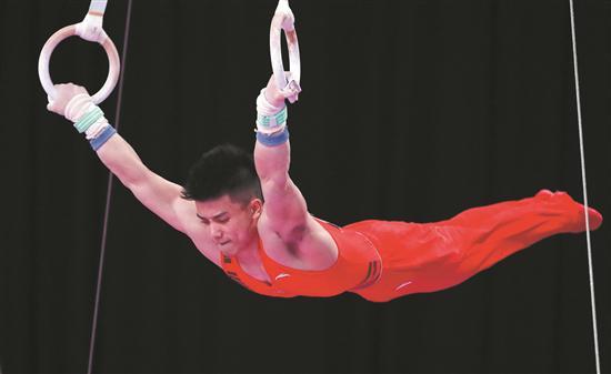 林超攀在吊环比赛中 (新华)