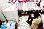 女子双手残疾用脚书写足下人生 想在厦门找份工作