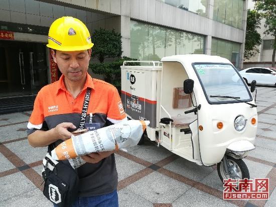 晋江规范合法后的电动快递三轮车。