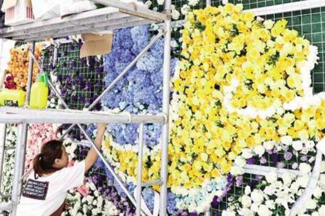 投洽会展馆布置充满创意 万朵鲜花筑墙真实飞机参展