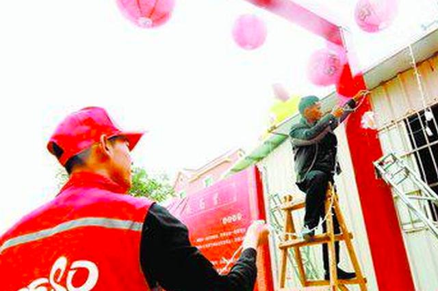 翔安红马甲春节服务忙 她怀孕跟丈夫一起志愿服务