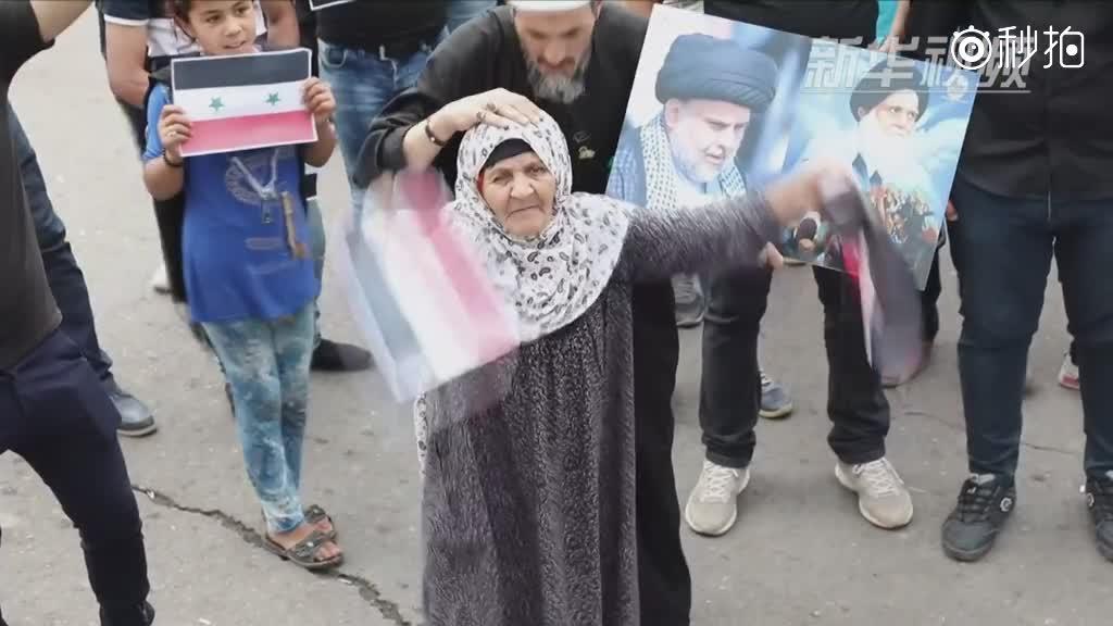 伊拉克民众抗议美英法空袭叙利亚