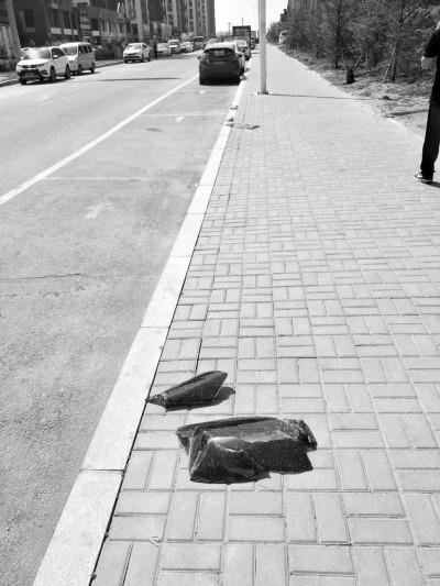 沈阳某小区附近16辆车集体被砸 有人丢了行车记录仪