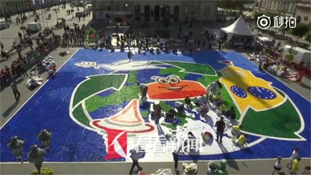 用塑料瓶盖在广场作画!300名塞尔维亚志愿者向世界传递爱