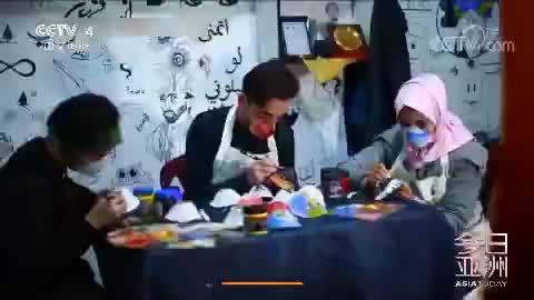 巴勒斯坦艺术家N95口罩作画 :鼓励人们戴口罩 提高防疫意识